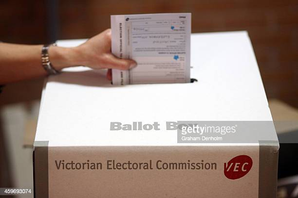 A member of the public votes in the Victorian State Election at the Caulfield District voting centre on November 29 2014 in Melbourne Australia