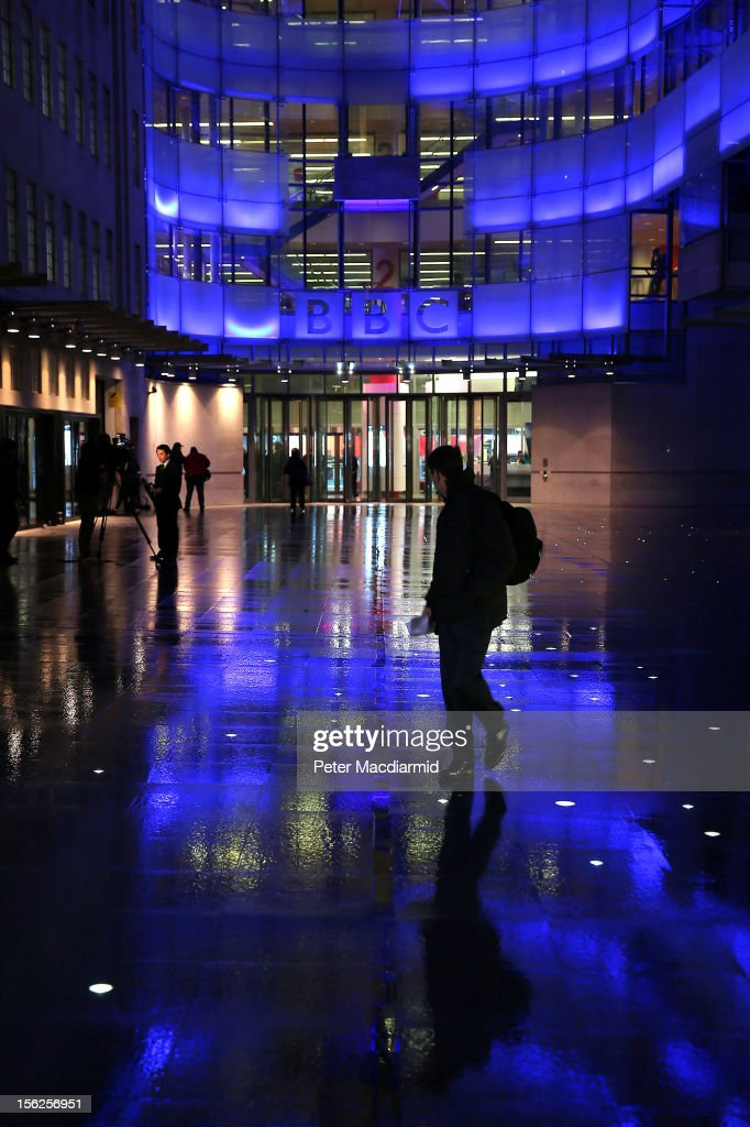 A member of the public walk outside the BBC headquarters at New Broadcasting House on November 12, 2012 in London, England. Tim Davie has been appointed the acting Director General of the BBC following the resignation of George Entwistle after the broadcasting of an episode of the current affairs programme 'Newsnight' on child abuse allegations which contained errors.