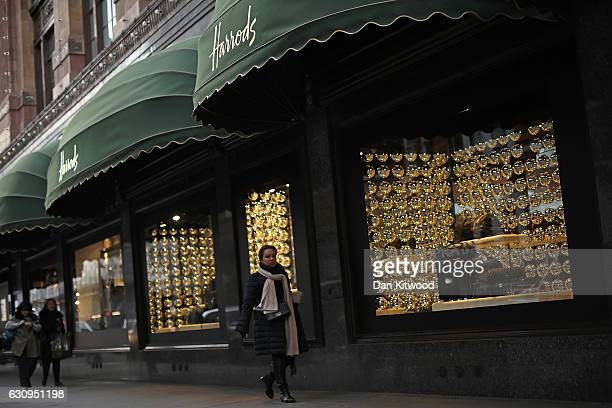 A member of the public walks past Harrods department store on January 4 2017 in London England The union that represents the catering staff at...