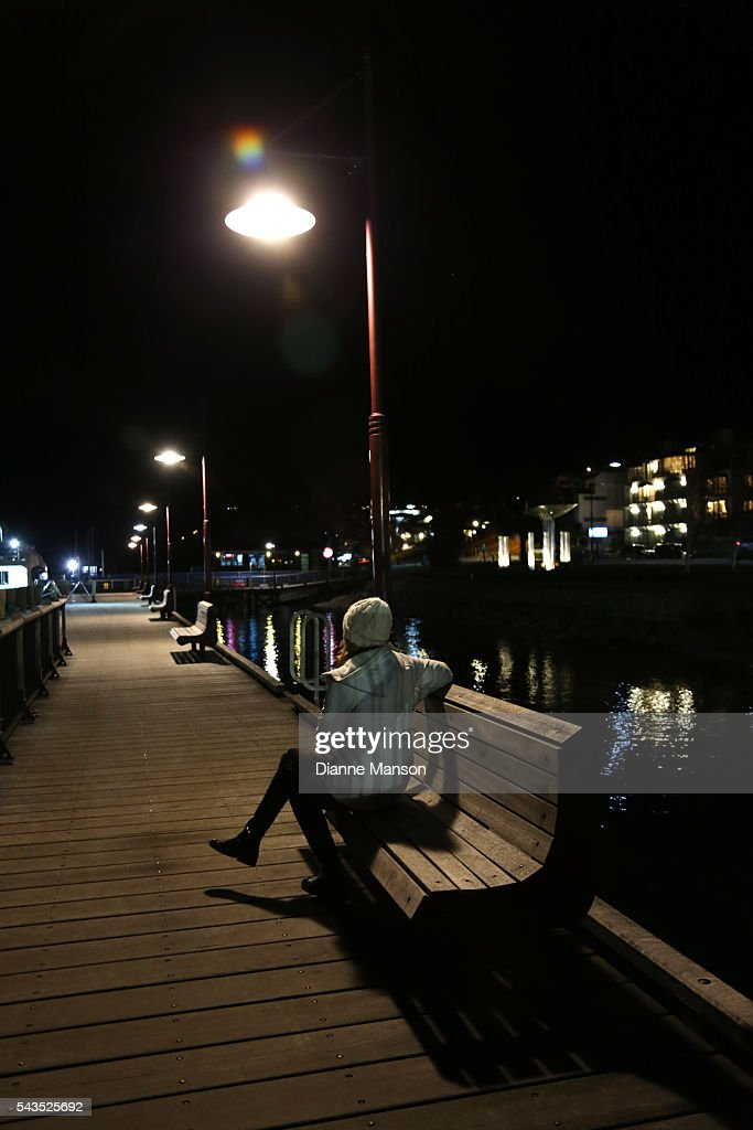 A member of the public watches as the historic TSS Earnslaw steamship leaves for the Mistletoe cruise during the Queenstown Winter Festival on June 29, 2016 in Queenstown, New Zealand.