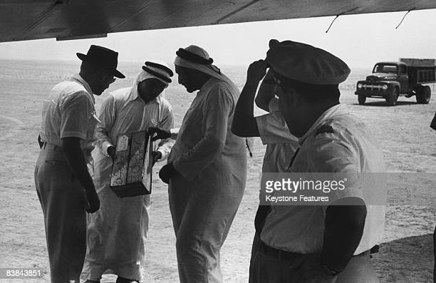 A member of the Qatari royal family inspects the contents of a cargo plane arriving in Qatar and chooses the best products for himself September 1953