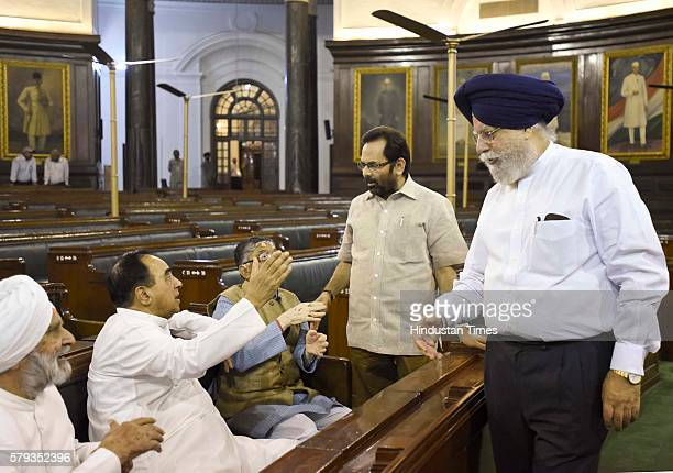 Member of the Rajya Sabha Subramanian Swamy talking to Minister of State for Parliamentary Affairs Mukhtar Abbas Naqvi and Minister of State for...