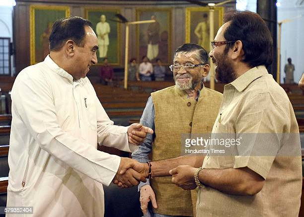 Member of the Rajya Sabha Subramanian Swamy talking to Minister of State for Parliamentary Affairs Mukhtar Aabbas Naqvi and Minister of State for...