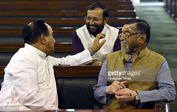 Member of the Rajya Sabha Subramanian Swamy talking to Minister of Human Resource Development Parkash Javadekar and Minister of State for Finance...