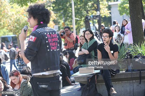 TORONTO ON OCTOBER 5 Member of the rally listens to Wesley Williams non binary activist and former U of T student as he speaks to the crowd at the...