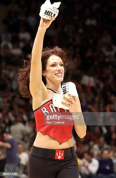 A member of the Raptors Dance Pack gives away tshirts during a game between the Toronto Raptors and the Philadelphia 76ers on December 18 2005 at the...