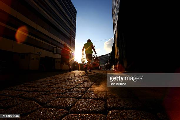 A member of the Red Bull Racing team carries equipment through the paddock as the team packs down after the Formula One Grand Prix of Russia at Sochi...