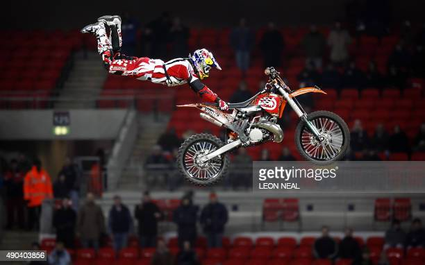 A member of the Red Bull XRiders Motocross display team gives a demonstration during a break in the Race of Champions event at Wembley Stadium London...