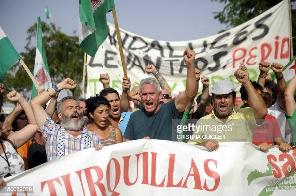 A member of the regional parliament for the United Left party in Andalucia Juan Manuel Sanchez Gordillo and the secretary general of the SAT...