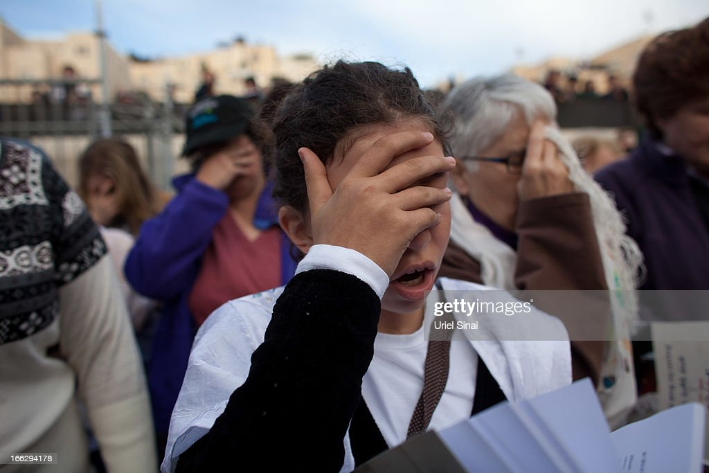 Member of the religious group 'Women of the Wall,' during a prayer marking the first day of the Jewish month of Iyar at the Western Wall on April 11, 2013 in Jerusalem's Old City, Israel. Five members of the organisation 'Women of the Wall' were detained by police during the group's monthly prayer at the Western Wall, after covering themselves with prayer shawls in contradiction to the holy site's custom.