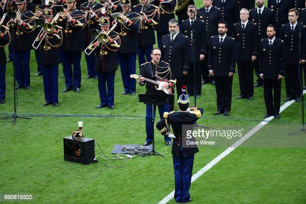 A member of the Republican Guard plays the Oasis song Don't Look Back In Anger as the teams come out for the International friendly match between...
