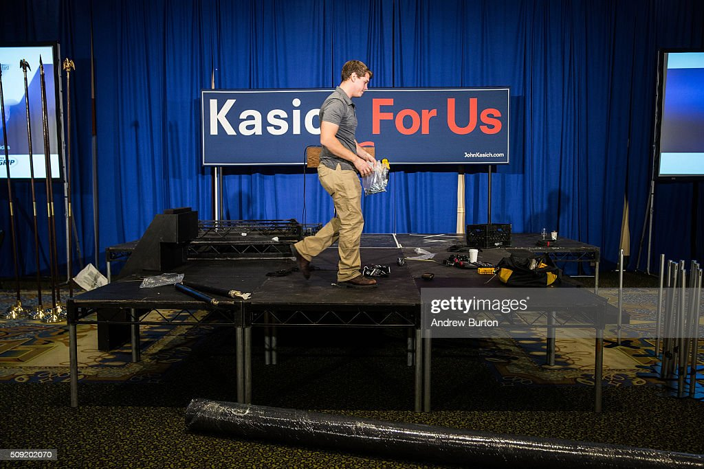A member of the Republican presidential hopeful Ohio Governor John Kasich's campaign prepares the room for Kasich's primary night gathering on February 9, 2016 in Concord, New Hampshire. Kasich is hoping to upset fellow Republican governor candidate Chris Christie and Jeb Bush with strong poll numbers.