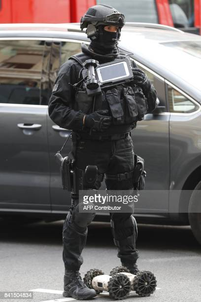 A member of the Research and Intervention Brigade of the French national police stand during a visit of French Interior Minister to the Paris Police...