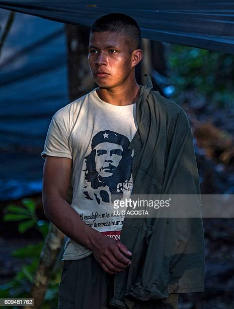 A member of the Revolutionary Armed Forces of Colombia wearing a shirt with Ernesto Che Guevara's image is seen at the camp in Llanos del Yari...