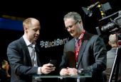 A member of the RIM team demonstrates one of the new touchscreen Z10 Blackberry devices to a television crew in central London at one of eight...