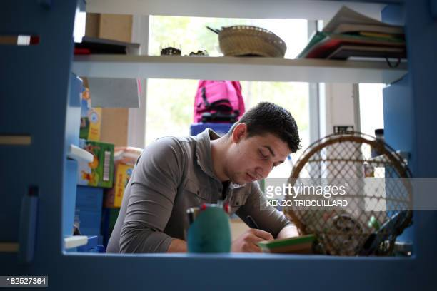 A member of the Roma community employed at a shop of international charitable movement Emmaus as part of a reinsertion programm is at work on...