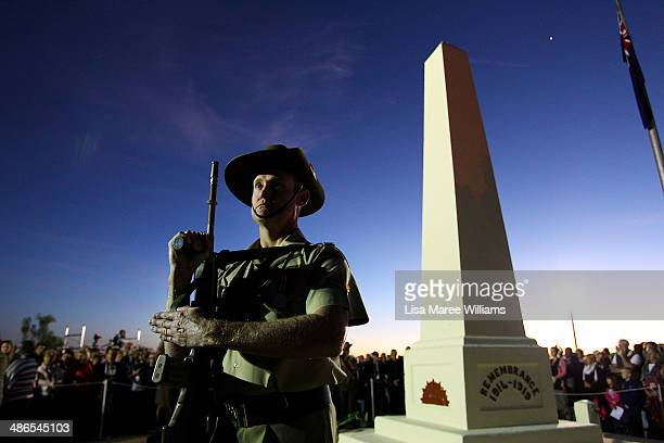 A member of the Royal Australian Army stands in silence near the Cenotaph during the Anzac Hill Dawn Service on April 25 2014 in Alice Springs...