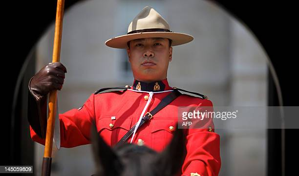 A member of the Royal Canadian Mounted Police stands guard at Horse Guards Parade in central London on May 23 as the RCMP take part in the 'Changing...