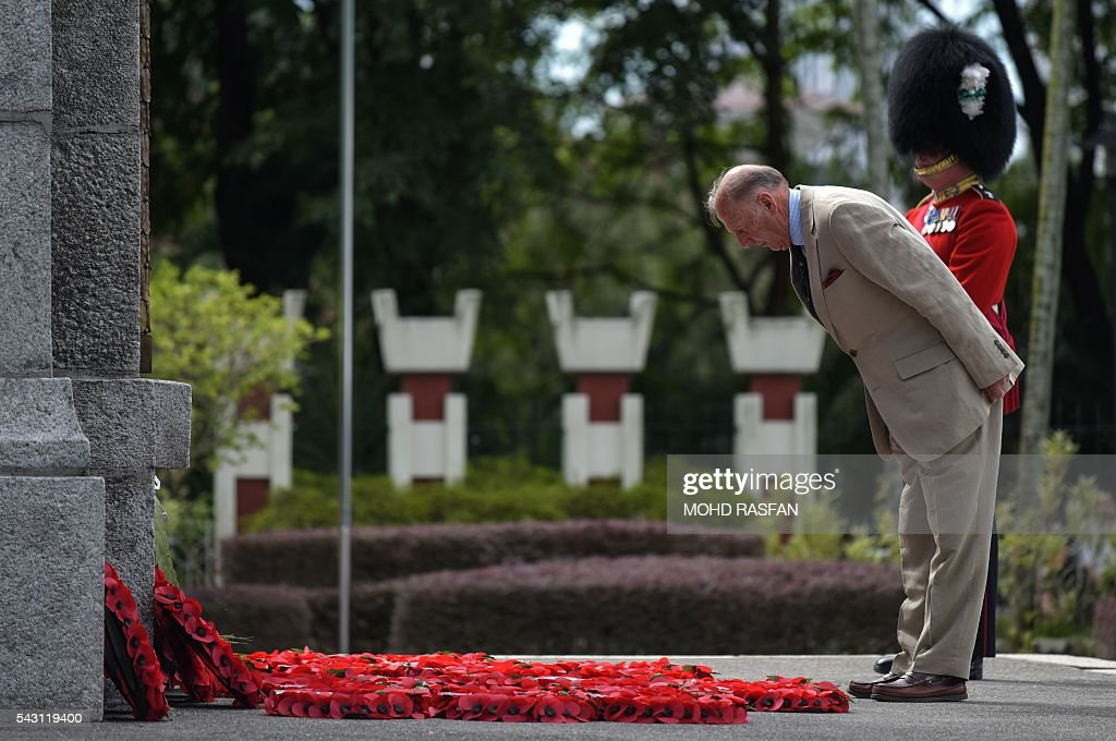 A member of the Royal Commonwealth Ex-Services League (RCEL) bows towards the cenotaph during a service of remembrance ceremony at the National Monument in Kuala Lumpur on June 26, 2016. The Royal Commonwealth Ex-Services League (RCEL) is a Commonwealth charity with 57 member organisations in 50 Commonwealth countries, including Malaysia. Malaysia was chosen to be the host of its 32nd conference from June 26 to 29. / AFP / MOHD