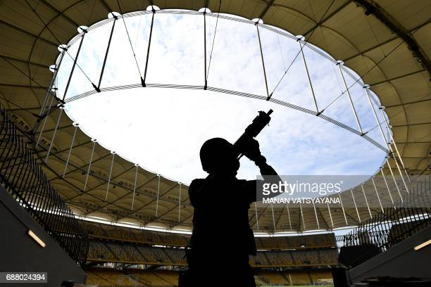 TOPSHOT A member of the Royal Malaysian Police Special Task Force leaves after taking part in a security drill at the Bukit Jalil National Stadium in...