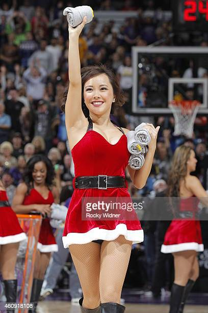A member of the Sacramento Kings dance team gives aways gifts during the game against the Los Angeles Lakers on December 21 2014 at Sleep Train Arena...