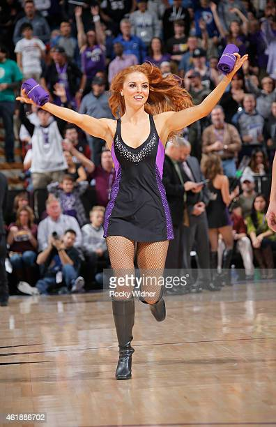 A member of the Sacramento Kings dance team hands out tshirts during the game against the Miami Heat on January 16 2015 at Sleep Train Arena in...