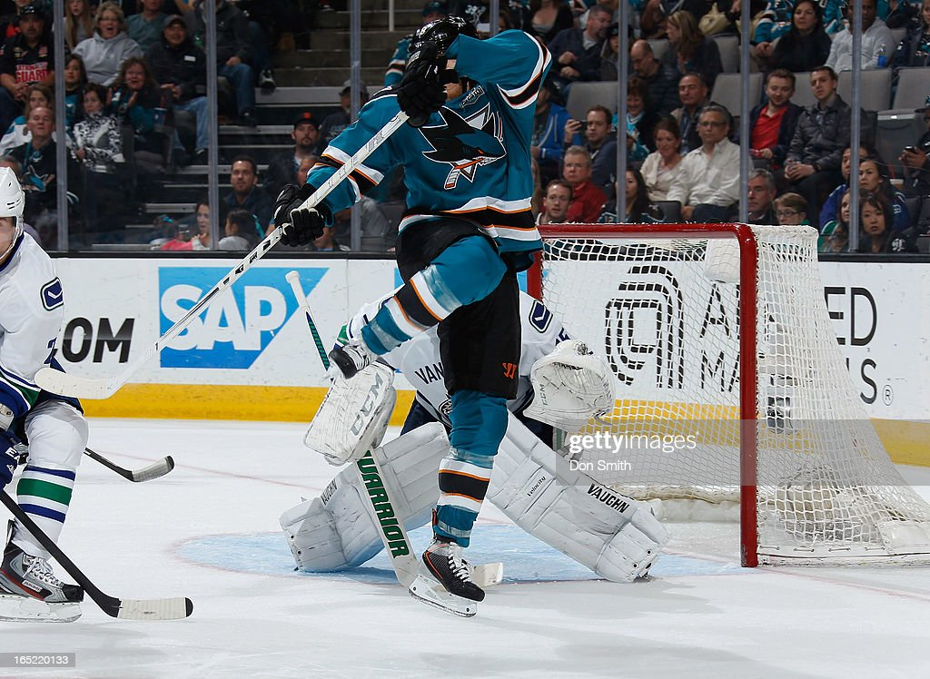 A member of the San Jose Sharks creates traffic in front of the net against <a gi-track='captionPersonalityLinkClicked' href=/galleries/search?phrase=Cory+Schneider&family=editorial&specificpeople=696908 ng-click='$event.stopPropagation()'>Cory Schneider</a> #35 of the Vancouver Canucks during an NHL game on April 1, 2013 at HP Pavilion in San Jose, California.