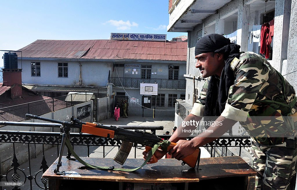 A member of the Sashastra Seema Bal (SSB) armed border force at a polling station for the Himachal Asembly election at Ganj Bazar in Shimla on November 04, 2012 in Himachal Pardesh, India. Voting figures have indicated a high percentage turnout for polling in the assembly election.