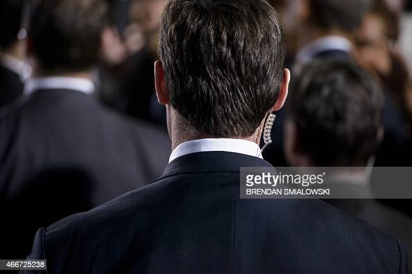 A member of the Secret Service looks on as US President Barack Obama greets guests at the City Club of Cleveland on March 18 in Cleveland Ohio Obama...