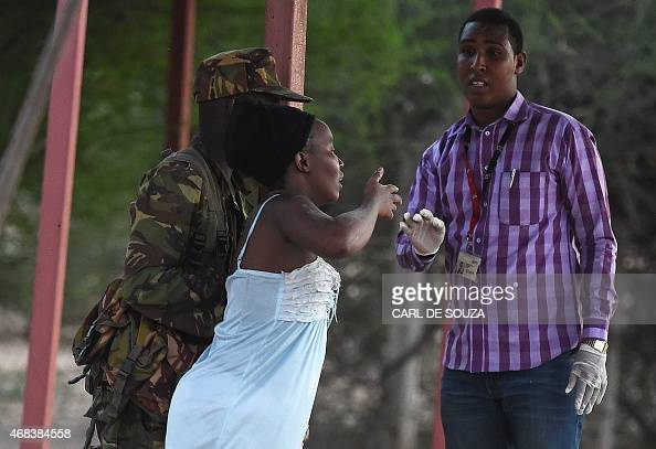A member of the security forces escorts a student out of a Kenyan University campus in Garissa on April 2 after an attack by Somalia's AlQaedalinked...