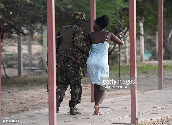 A member of the security forces escorts a student out of Garissa University campus in Garissa on April 2 after an attack by Somalia's AlQaedalinked...