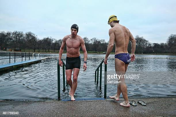 A member of the Serpentine Swimming Club enjoys an early morning swim in Serpentine Lake in Hyde Park on January 19 2015 in London England The...