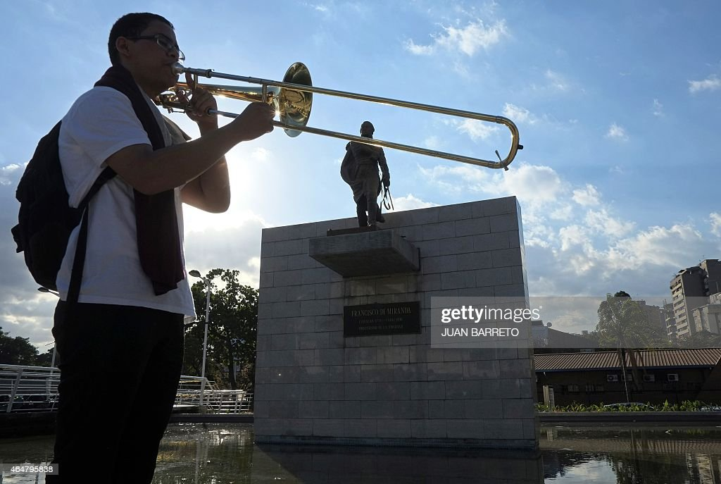 A member of the <a gi-track='captionPersonalityLinkClicked' href=/galleries/search?phrase=Simon+Bolivar&family=editorial&specificpeople=151017 ng-click='$event.stopPropagation()'>Simon Bolivar</a> Symphony Orchestra tries his trumpet before a free concert in a square east of Caracas on February 28, 2015.