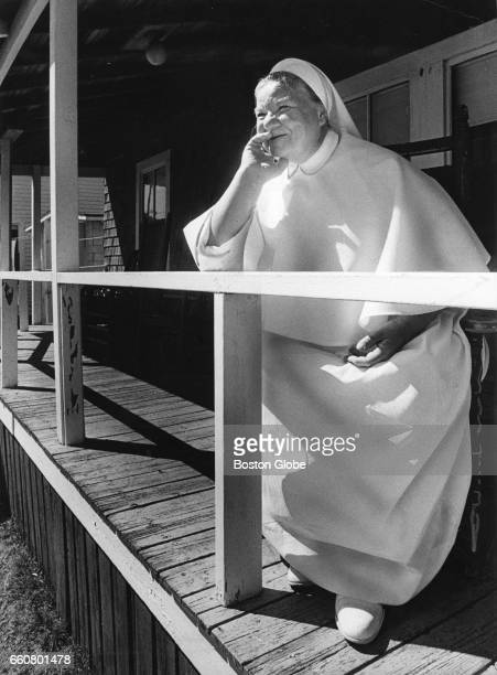 A member of the Sisters of Charity visits her brother at his cottage at White Horse Beach in Plymouth MA on Sep 11 1972 She is stationed at Hamilton...