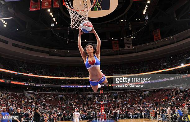 A member of the Sixers Dancers dunks the ball during the Philadelphia 76ers game against the Golden State Warriors on November 23 2008 at the...