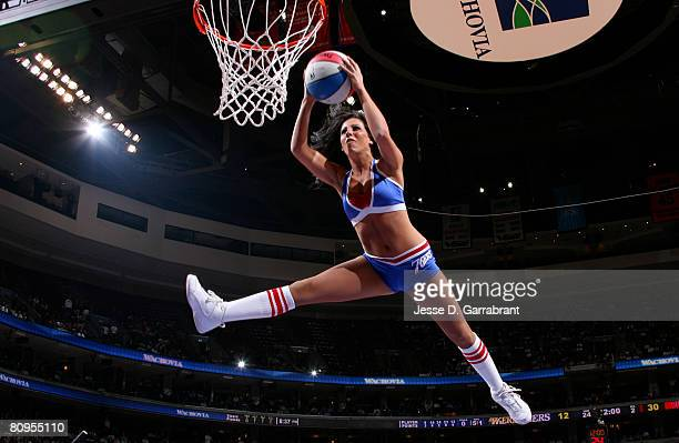 A member of the Sixers Dancers shoots the ball in Game Six of the Eastern Conference Quarterfinals during the 2008 NBA Playoffs between the...