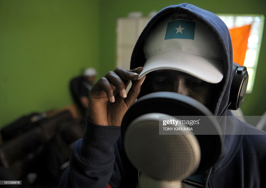 A member of the Somali rap group Waayaha Cusub (New Era in Somali) sings on May 20, 2010 during a recording session at a makeshift studio in Nairobi. Refugees in Kenya since a very early age, the Somali rappers are defying through their lyrics Islamist warlords in their wartorn-country. The group of 10 members was founded in 2004 and quickly made a sensation by attacking the Somali warlords and making girls dance on stage. In recent months, the musicians are targetting the Somali hardline insurgent group, Al-Shehab, about whom they've composed and recorded six songs and a video clip. AFP PHOTO/Tony KARUMBA