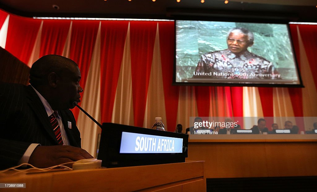 A member of the South African delegation watches a video presentation of Nelson Mandela at an informal meeting of the plenary of the General Assembly, on the commemoration of the Nelson Mandela International Day, at U.N. headquarters on July 18, 2013 in New York City. South Africa's first black president and anti-apartheid leader turns 95 today on his 41st day in the hospital.