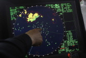 A member of the South Korean Coast Guard checks the radar during the search for missing passengers at the site of the sunken ferry off the coast of...