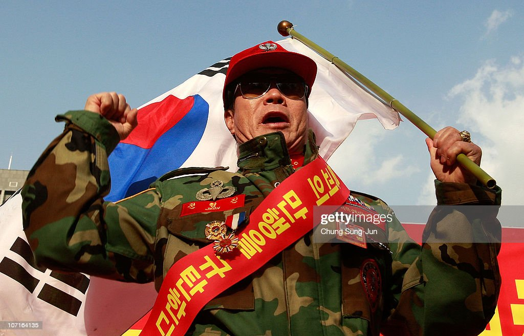 Member of the South Korean Marine Corps Veterans Association participate in a rally commemorating the two marines killed in a North Korean artillery...