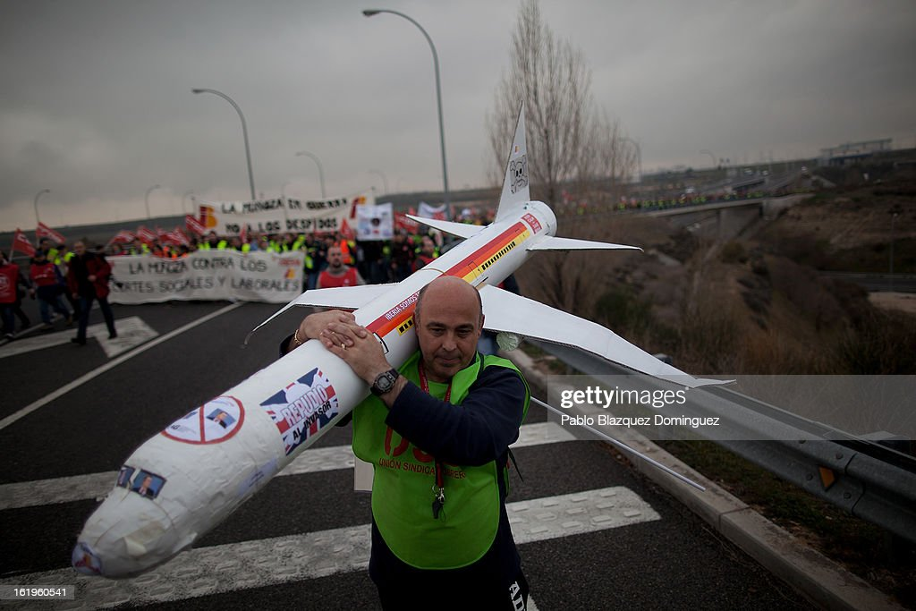 A member of the Spanish Airline Iberia carries a model plane during a protest against job cuts at Barajas Airport on February 18, 2013 in Madrid, Spain. Today is the first of a five day strike held by Iberia cabin crew, maintenance workers and ground staff in response to the planned loss of 3,800 jobs. The strike has resulted in the airline having to cancel 400 flights this week with unions planning a further five day strikes within a month.