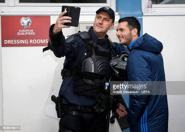 Member of the special police force takes a selfie with Miralem Pjanic of Bosnia and Herzegovina prior the FIFA 2018 World Cup Qualifier between...