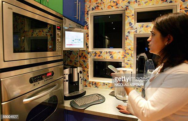 A member of the staff museum is trying to order food via internet inside the House of the Future exposed at the museum of communication in Lisbon 24...
