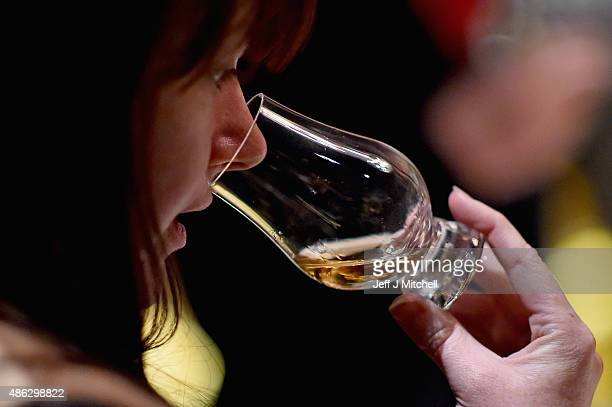 A member of the staff noses whisky samples inside the Diageo Claive Vidiz Collection the world's largest collection of Scottish Whisky on display at...