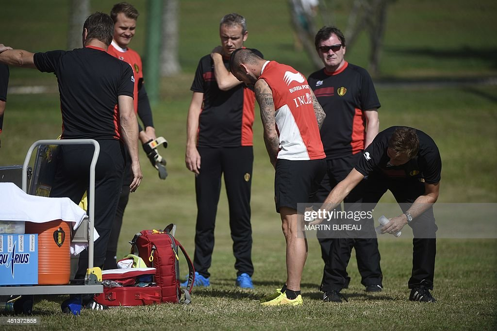 A member of the staff sprays anti-mosquito spray on Belgium's midfielder Steven Defour's legs during a training session in Mogi das Cruzes on June 28, 2014 during the 2014 FIFA World Cup football tournament in Brazil.