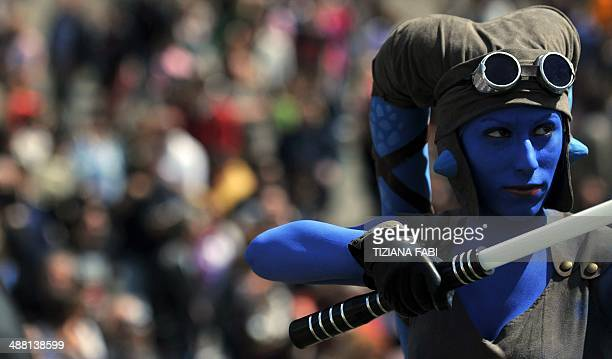 A member of the Star Wars fan club dressed as Aayla Secura celebrates 'Star Wars Day' in front of the Colosseum in central Rome on May 4 2014 AFP...