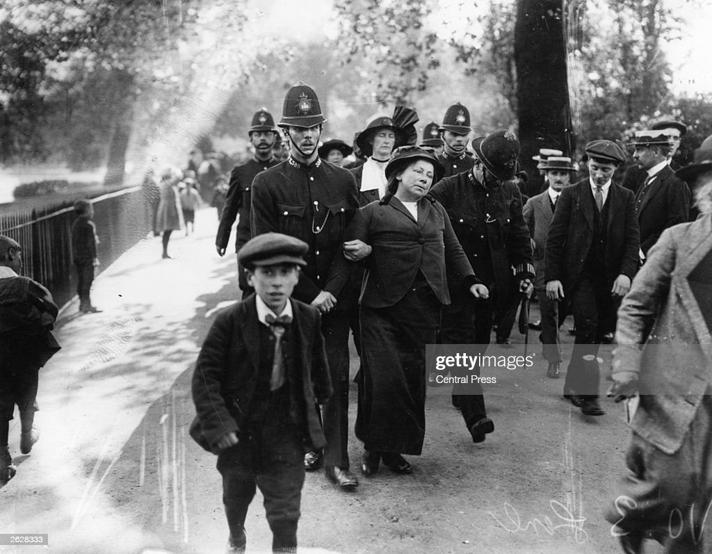 A member of the Suffragette Movement is arrested by a London policeman at a demonstration outside Buckingham Palace.