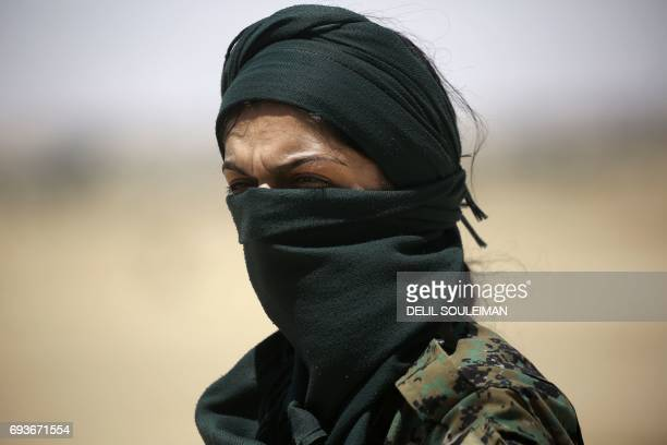 CORRECTION A member of the Syrian Democratic Forces made up of an alliance of Kurdish and Arab fighters stands some two kilometres from the AlMeshleb...
