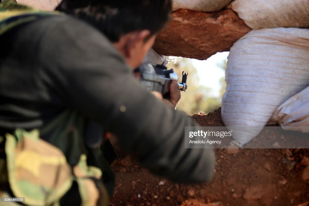 A member of the Syrian opposition forces takes aim at a position during the clashes against the Shiite militia forces in Khan Tuman village in southern outskirts of Aleppo, Syria on April 29, 2016.