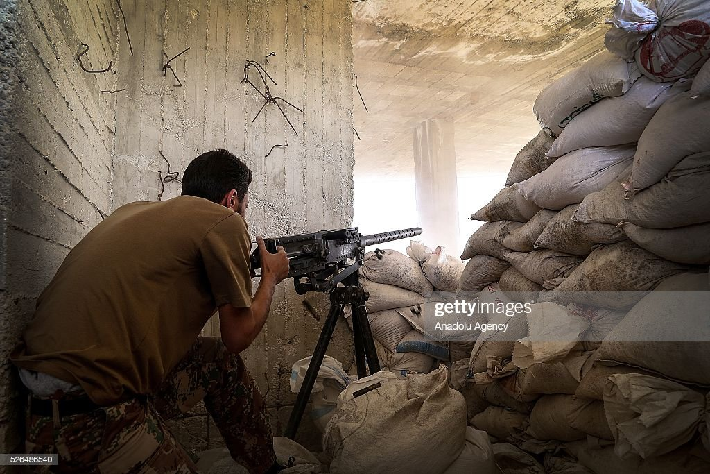 A member of the Syrian opposition forces takes aim at a position during the clashes against the Shiite militia forces in al-Rashedin neighborhood Aleppo, Syria on April 27, 2016.